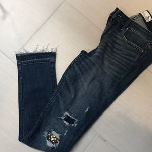 Distressed studded dark wash jeans